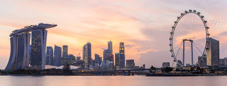 standalone: SINGAPORE - FEBRUARY 15: The Marina Bay Sands Resort Hotel at sunset on Feb 15, 2014 in Singapore . It is an integrated resort and the worlds most expensive standalone