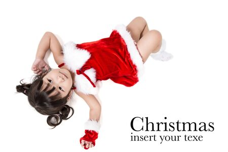 santa suit: Portrait of little girl in red santa suit on white background.