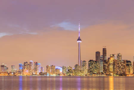 Toronto city dusk over lake with colorful light, canada.