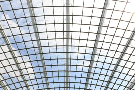 limpid: the metal and glass roof inside of office center