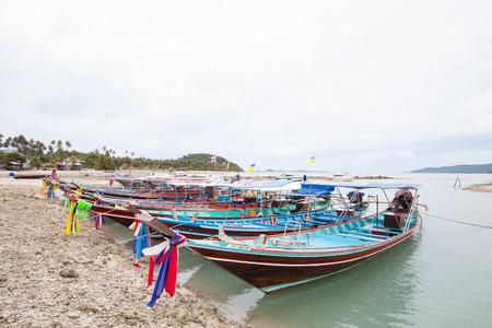 dive trip: motor long tail boat parking at Phi Phi beach Phuket Thailand Stock Photo
