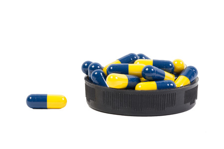 Yellow and blue Capsule on white background photo