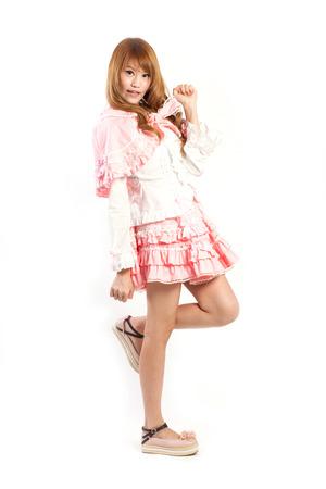lolita: lolita cosplay woman on white backboard. Stock Photo