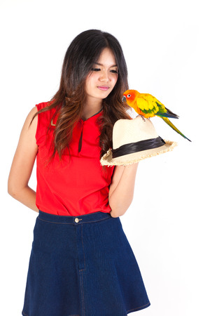cheeky: Cheeky Cockatiel parrot on the hat woman Stock Photo