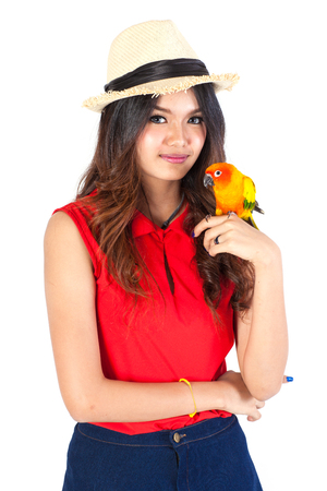 cheeky: Cheeky Cockatiel parrot and woman Stock Photo