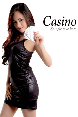 Casino concept- Pretty woman show a card. Stok Fotoğraf
