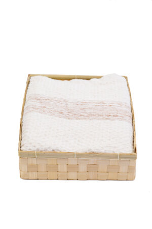 necessity: Towel in basket bamboo use at Spa on the white background
