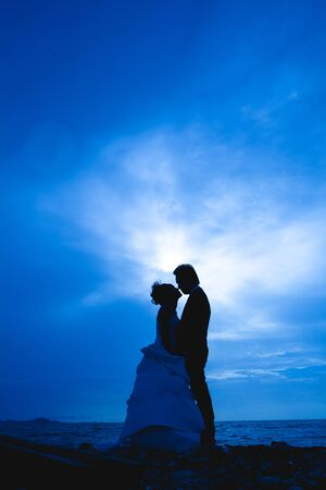 love shape: sillhouette couple scene in love sunset.