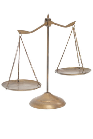 lawfulness: golden brass scales of justice on the white background.