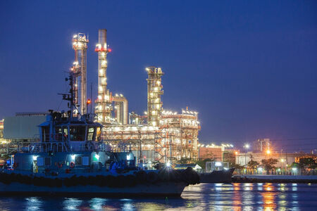 catalyst: petrochemical plant and tanker in night Editorial