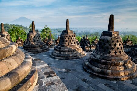 jogjakarta: Borobudur Temple on top at sunrise.Indonesia. Stock Photo
