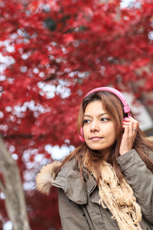 Beautiful asian woman standing in autumn season on nami island, Korea. photo