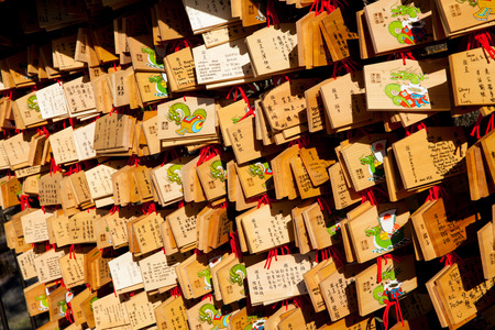 happieness: KYOTO, JAPAN - 27 NOV: Dragon wooden prayer tablets at Kiyomizu dera Kyoto on 27 November 2012 (The Dragon year). Pray for happieness good life healthy peace luck by write praying word in wooden.