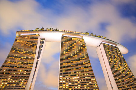 billion: SINGAPORE-FEBRUARY 14: The Marina Bay Sands Resort Hotel on Fab 14, 2012 in Singapore. It is an integrated resort and the worlds most expensive standalone casino property at S$8 billion.