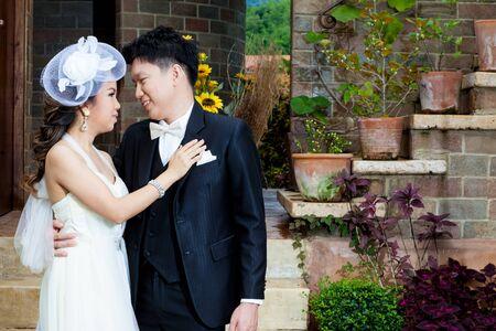 thai dance: bride and groom couple wedding in love Stock Photo