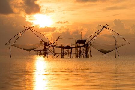 thialand: Silhouette traditional horse asia fishing net on sunrise, Thialand. Stock Photo