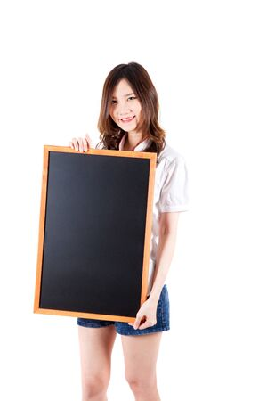 cardboard only: Young Woman Holding Up a blackboard. Studio shot