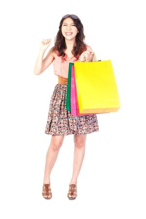 Woman with shopping bags on the white background. photo