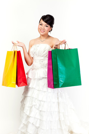 bellydance: bride with shopping bag on the white background.