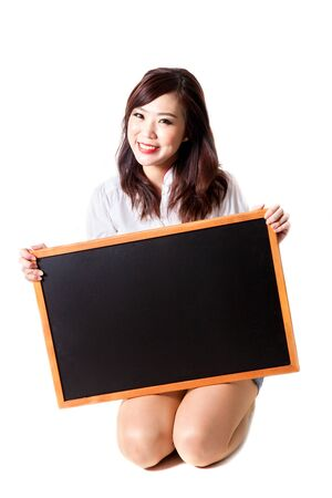 teenaged girls: girl with blackboard on white Stock Photo
