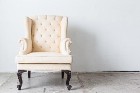 sofa: White vintage sofa on white wall. Stock Photo