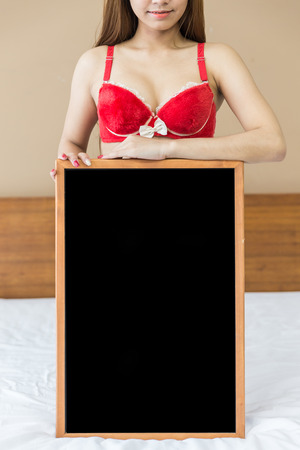 chinese sex: Female sexy in red streak of the body part and black board.