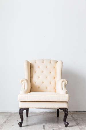 white sofa: White sofa armchair on white wall. Stock Photo