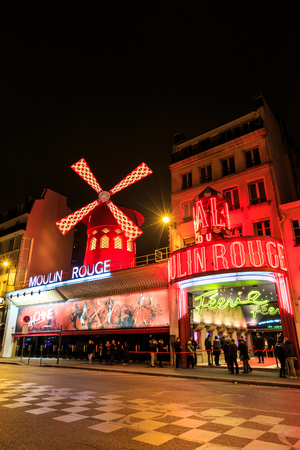locating: Paris, France - MARCH 15, 2015: The Moulin Rouge by night. Paris. France. Moulin Rouge is a famous cabaret, locating in the Paris red-light district of Pigalle. Travel (vacation) concept. Editorial