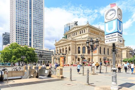 oper: FRANKFURT, GERMANY - JULY 8: view to Opernplatz and Opera House of Frankfurt partly under reconstruction with fountain early morning on July 8, 2015 Frankfurt, Germany. Editorial