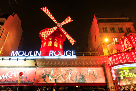moulin: Paris, France - MARCH 15, 2015: The Moulin Rouge by night. Paris. France. Moulin Rouge is a famous cabaret, locating in the Paris red-light district of Pigalle. Travel vacation concept.