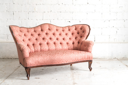 Delicieux Pink Vintage Sofa On White Wall. Stock Photo   56552224