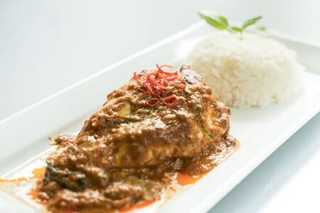 meaty: Chicken Curry thai food red sauce with rice.