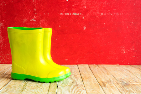 gumboots: Gumboots on wooden old background wall