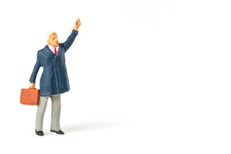 Miniature people businessman on white background with a space for text Imagens