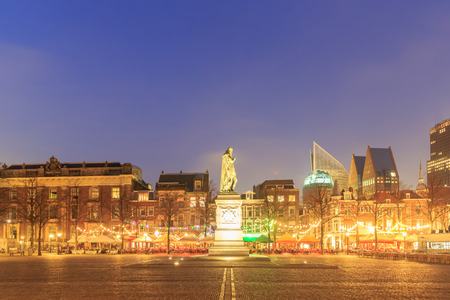 'the hague': City center square of the Dutch town The Hague at night, Netherlands.
