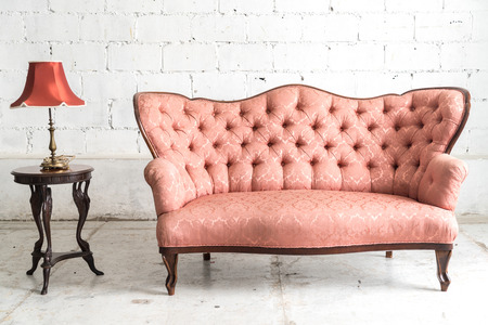 Ordinaire Pink Vintage Sofa And Lamp On White Wall. Stock Photo   66749130