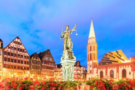 church steeple: old town with the Justitia statue in Frankfurt, Germany