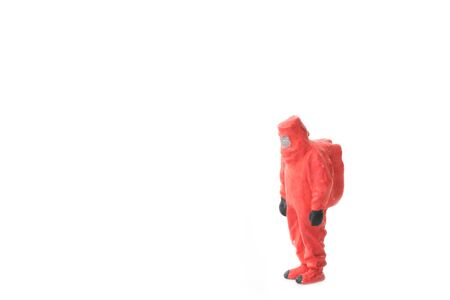 Miniature people  firefightes in hazmat suits construction concept on white background with a space for text