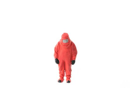 hazmat: Miniature people  firefightes in hazmat suits construction concept on white background with a space for text