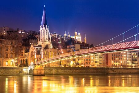 View of Saone river, Famous church in Lyon city at evening, France.