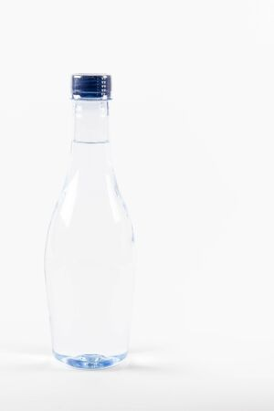 purified: Plastic bottle of drinking water on white background. Stock Photo