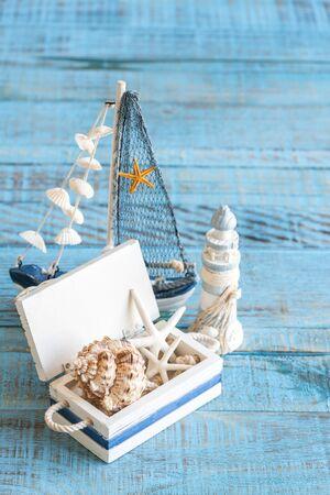 Sea theme decorations. Decorative marine items on wooden background.