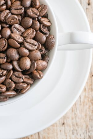 coffee beans on old wooden table background
