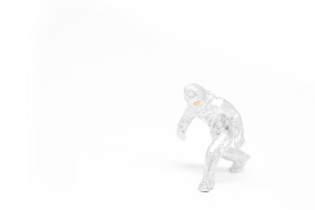 Miniature people firemen in hazmat suits construction concept on white background with a space for text