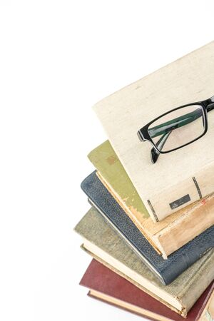 collection of old books on white background Stock Photo