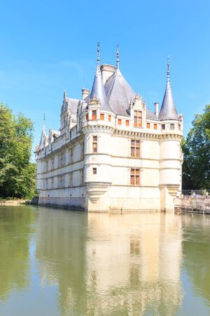 LOIRE, FRANCE - JUNE 16: Azay le Rideau castle with its moat in the Loire Valley on June 16, 2014, France. This castle was built in the XVIth century on an island among the Indre river.