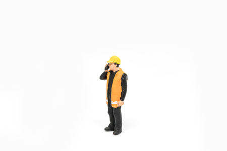 Miniature people worker wearing safety construction concept on white background with a space for text Stock Photo