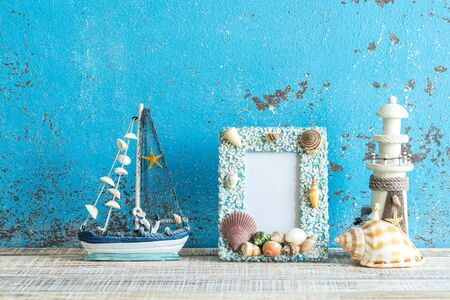 Decorative marine items on wooden background. sea theme decorations.