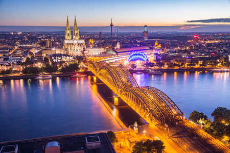 sunset of Cologne Cathedral and Hohenzollern Bridge, Cologne, Germany Stock Photo