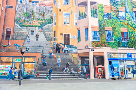 LYON, FRANCE - MARCH 16, 2016:  Mur des Canuts (1987) in the Croix-Rousse district. The huge mural is a realistic painting of a Lyon scene, part of the